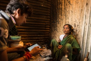 Woman sharing information about her illness with a TARU surveyor.