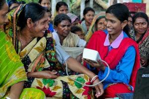 Sayeda Akhtar checking the blood pressure of village women.