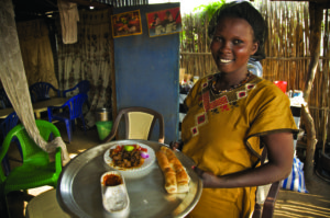 Young girl running a restaurant cum bar, in Juba, the capital of South Sudan