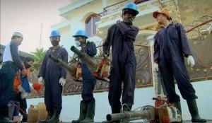 Workers preparing to use leaf blowers.