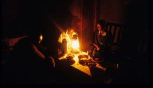 Julita Okiru cooking in the kitchen hut.