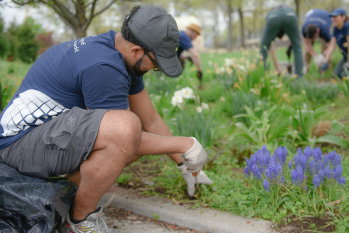 RF New York Staff completing a park cleanup as part of the Spring Day of Service.