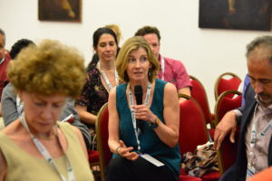 Woman asking a question at the Controluce Bellagio Solvable Convening.