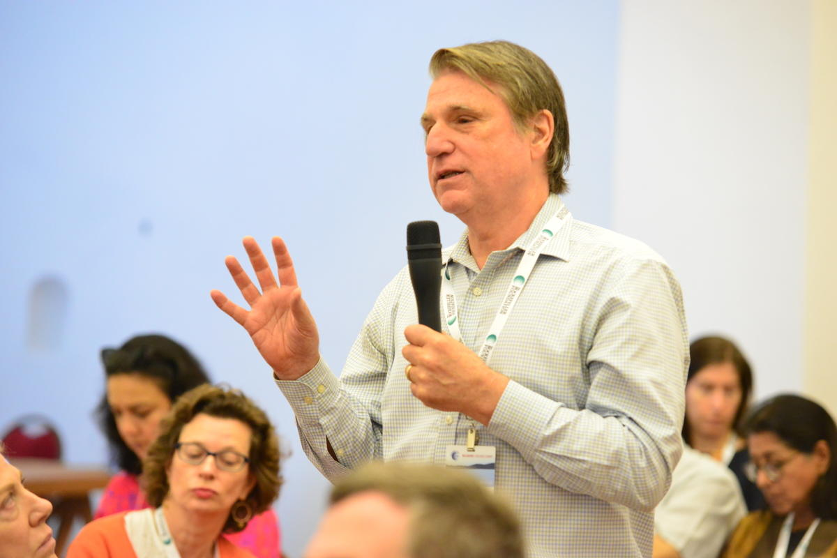 Man asking at a question at the Controluce RF Bellagio Solvable Convening