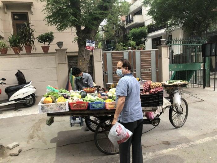 Street vendor selling produce.