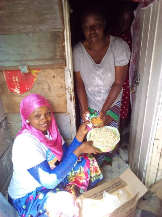 Woman serving another woman food.