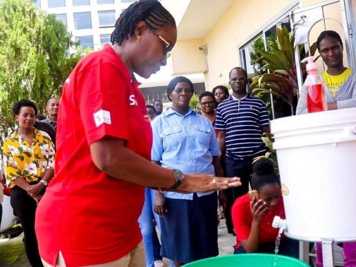 Group of people learning how to hand wash.