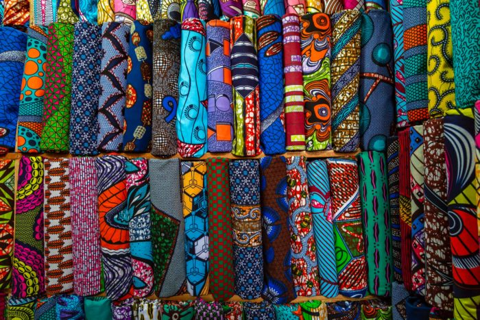 Various colored fabrics lined up in rows.