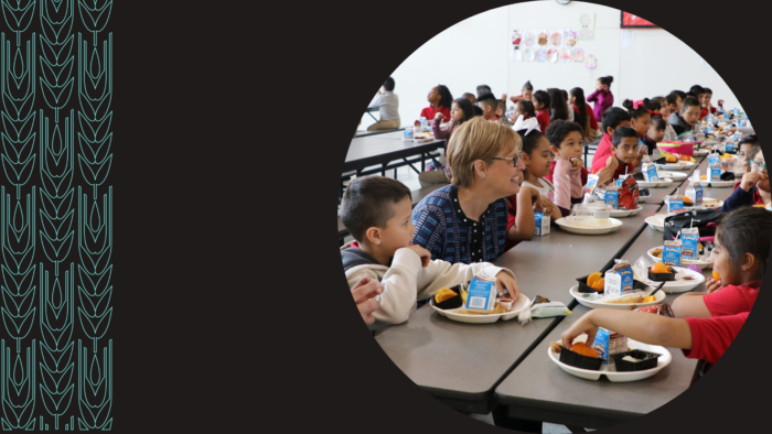 Katie Wilson, Urban School Food Alliance executive director, joins students for a school lunch.