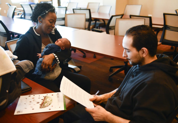 A woman and baby receive family EITC tax benefits.