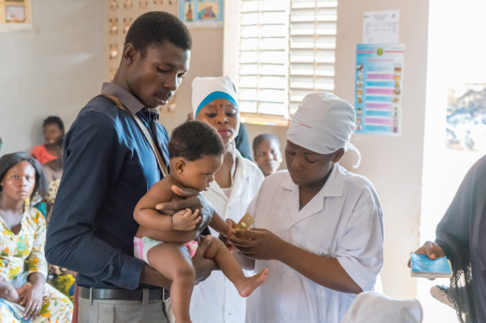 Nurse administering a vaccine to a baby at a Gavi Centre.
