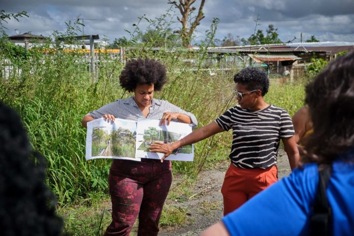 Mapenzi Nonό and Mulowayi Iyaye Nonό, co-founders of La Conde Project in San Juan, Puerto Rico explaining their initiative to onlookers.