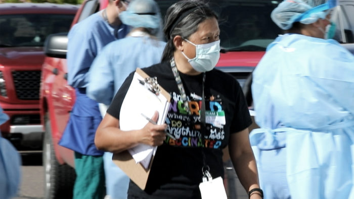 Volunteer wearing a mask.