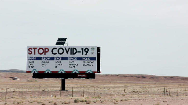 Billboard sign detailing ways to prevent the spread of Covid-19.