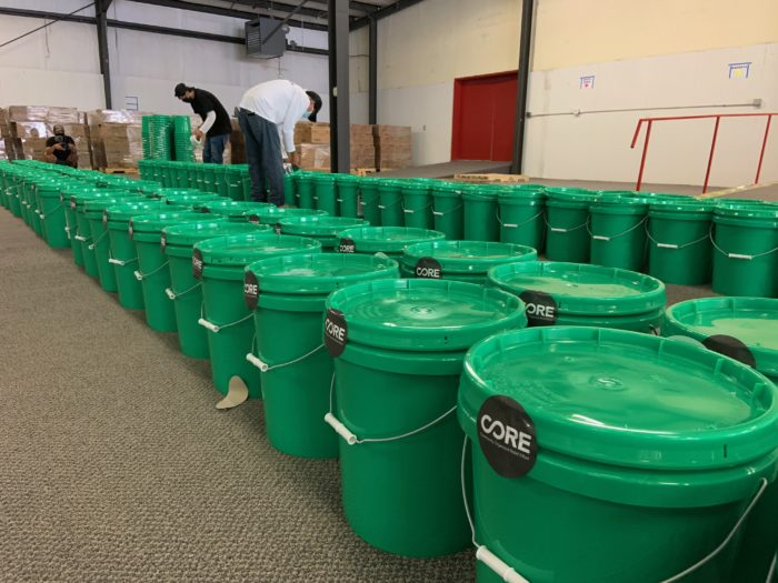 Rows of green bins containing Covid-19 tests.