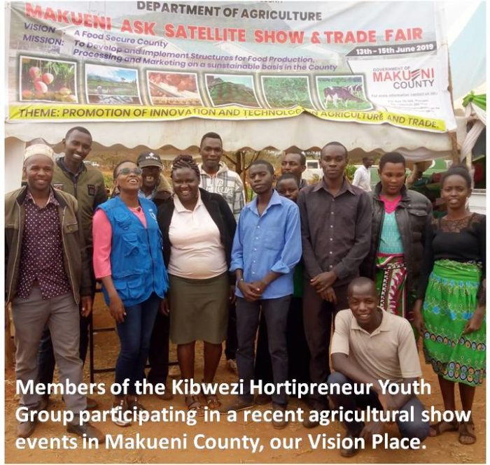 Group participating in an agricultural show standing together.