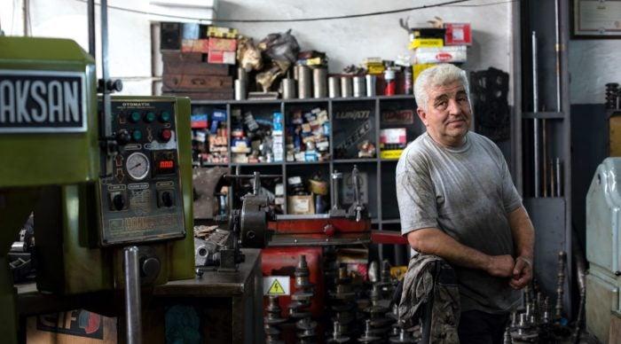 A man working in a garage.