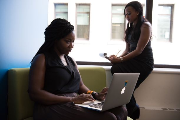 Two woman working in an office.