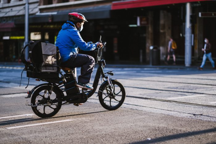 A man riding a bicycle.