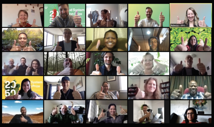Members of a video conference putting their thumbs up.