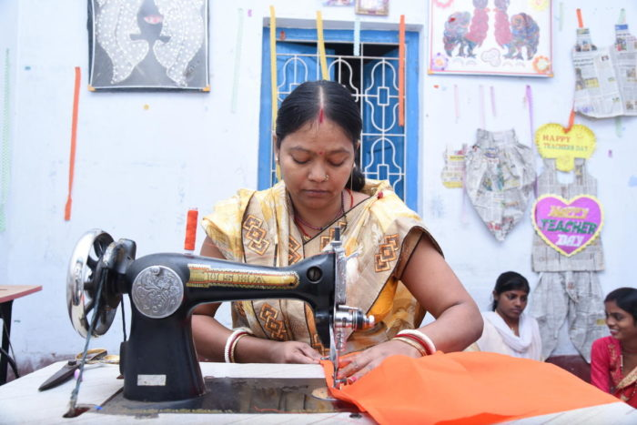 Ruby Kumari at work in her Sewing Center.