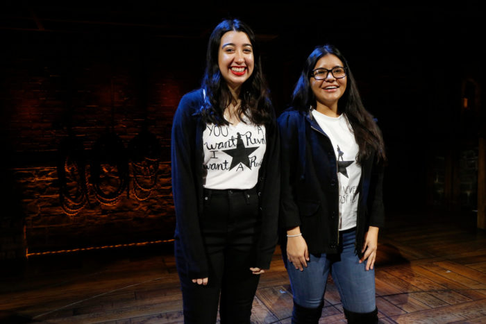 Two female high school students standing on the set of Hamilton as part of the Hamilton Education Program.