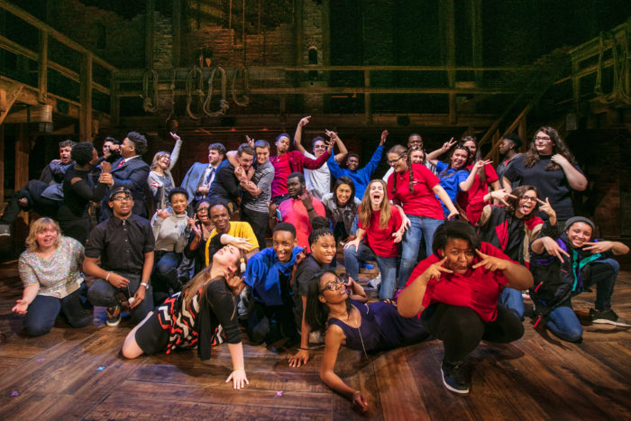 Student participants gathered on the set of Hamilton.