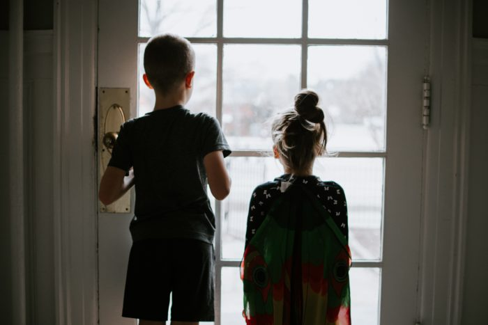 Children peering out the windows.
