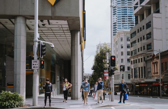 people standing on the sidewalk