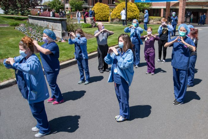 Nurses and therapists pose for a photograph outside Manchester Memorial Hospital.