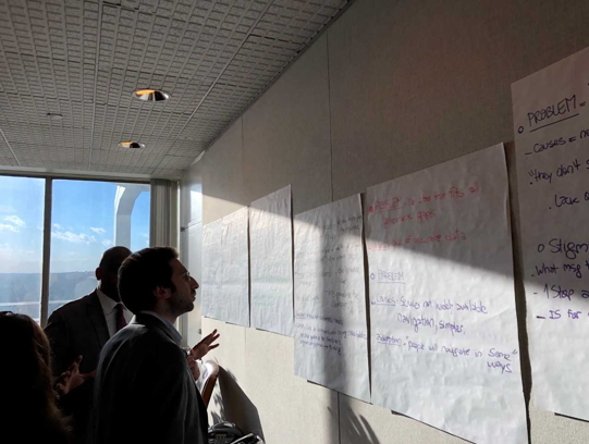 NJ Jobs partners look at white board of information