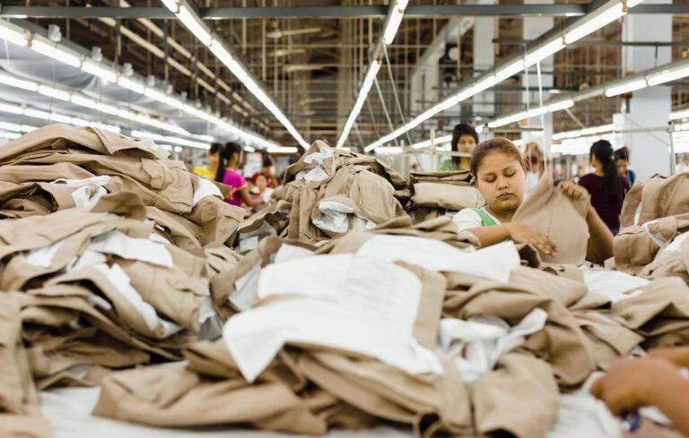 group of women folding fabrics