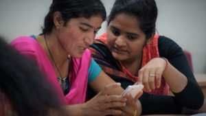 Women at a training event for smartphone-based data collection in their roles as Resident Enumerators (RE) for the PMA2020 project in Rajasthan, India. © 2016 Linnea Zimmerman/PMA2020, Courtesy of Photoshare