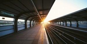 Empty train station at sunset.