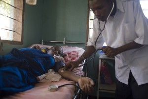 Doctor treating a patient in Africa.