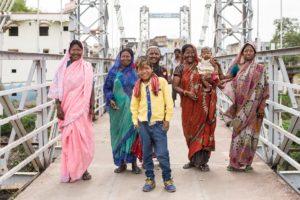 Family crossing a bridge outside Indore city.