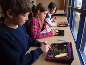 Elementary students using iPads at school.