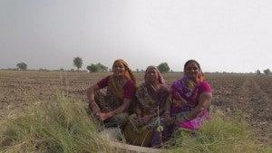 Women sitting in a field.