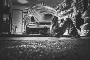 Car mechanic working on a Beetle in the Shop.