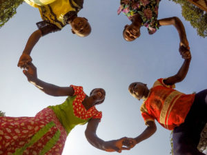 Joyce Anyango Otieno plays with her children at her home in Siaya County, Kenya.