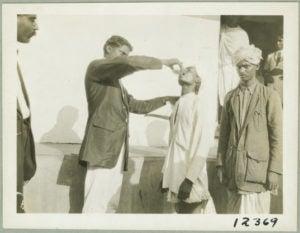 Doctor administering hookworm treatment at Karapa, India.