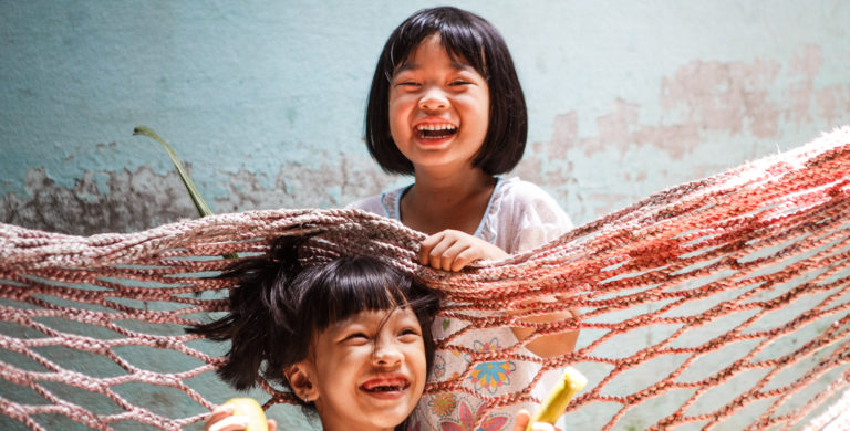 Smiling healthy children in Asia.