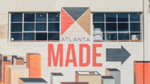 """Exterior of a building with """"Atlanta Made"""" painted on the side."""