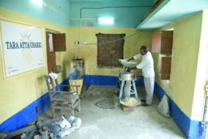 Man working in a Flour Mill in Parsa, Bihar.