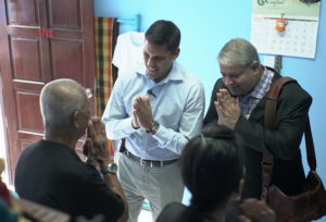 Dr. Rajiv Shah and Ashvin Dayal meeting with locals.