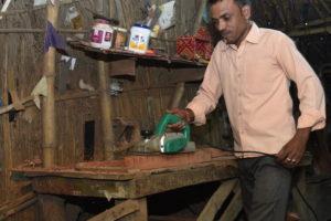 Suresh Kumar at work in his carpenter shop.