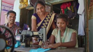 Family sewing in India.