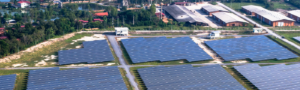 Aerial view of a field filled with solar panels.