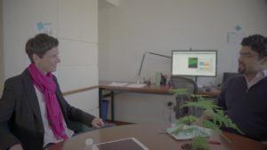 Man and a woman conversing at Good Talk - We Robotics' Betschart.