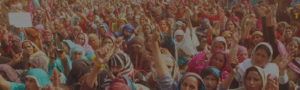 Crowd of female protesters raising their arms in unison.